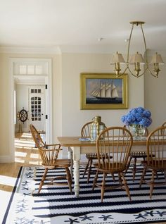 New England style dining room with windsor chairs and nautical decor accents