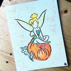 Tinker bell on a couple of pumpkins done in watercolor