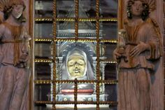 Saint Catherine of Sienna: A dismembered holy head stares out from her beautiful reliquary at the St. Dominic Basilica
