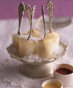 """Champagne popsicles with silverware """"sticks"""" -- perfect for a summer toast! Image and recipe via Living at Home"""