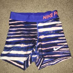 Nike Pro Spandex Super cute and excellent condition Nike pro spandex shorts! Very light cracking on Nike sign, but besides that absolutely nothing wrong with them. They are just too small. Trying to sell ASAP so accepting reasonable offers Nike Shorts