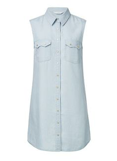 100% Lyocell Chambray Shirt dress. Neat fitting silhouette. Features a front button placket and pockets. Available in Chambray as seen below.