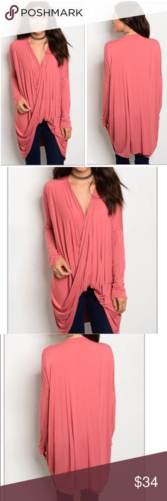"""Draped tunic top Muted rust colored long sleeved draped tunic top. Surplice neckline, oversized fit. Soft! 92% rayon 8% spandex. Made in USA.                                                                S-bust 24"""", front length 29"""", back 35""""                                   M-25"""", 30"""", 36""""                                                                        L-27"""", 33"""", 37"""" Tops Tunics"""