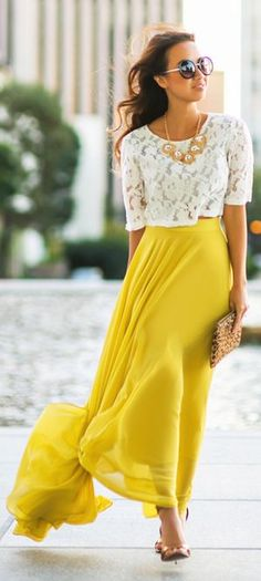Something like this - boxy crop and high waisted flowy maxi skirt - but don't like the lacy top or the mustardy yellow. But like the shapes for upcoming vacation.