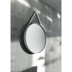 HAY Strap Mirror by HAY Studio. HAY Strap Mirror is a mirror suitable for any environment. It has a powder-coated steel frame and a cool silicone grey strap. It is available in two sizes - diameter or diameter. Urban Living, Hay Design, Design Shop, Circular Mirror, Round Design, Round Mirrors, Mirror Mirror, Ideas