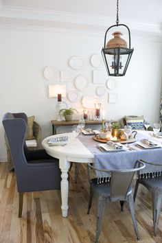 Beautiful plate wall in an eclectic dining room by @theinspiredroom
