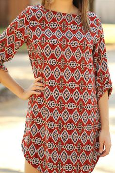 Love this dress, just add a long simple necklace so it doesn't compete with the pattern on the dress