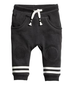 Joggers in soft sweatshirt fabric with an elasticized drawstring waistband, front pockets, and ribbed hems. Soft, brushed inside. - Visit hm.com to see more. Size: 1.5-2yo