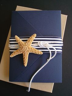 cute wrapping for invitations or gift cards. i would use a fake starfish though, or an anchor charm