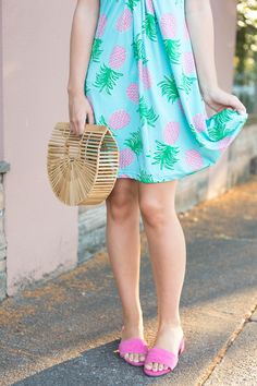 Are you looking for a cute and comfy summer dress? It makes for the perfect summer outfit idea with the pineapple print and pink sandals. This summer purse is perfect too if you want something fun for the warm weather! | fashion blog, fashion tips and tricks