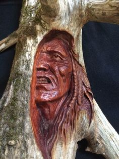 "Billy Reynolds at www.smokypearlart.com  Name:  Native American Spirit Face  Media:  Wood Carving  Artist:  Billy Reynolds  Price: $225.00  ​Size: 18"" x 12""  Info: Cedar  Item #: BR020"