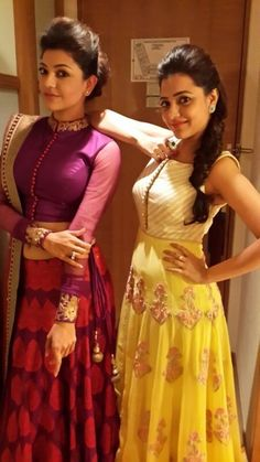 The Aggarwal sisters attended the CineMaa Awards tonight in Hyderabad wearing SVA by Sonam and Paras Modi. Kajal went for a more mature look in a purple lehenga and an updo while Nisha kept it fun in a floral yellow floor-length gown. Indian Attire, Indian Ethnic Wear, Indian Dresses, Indian Outfits, Indiana, Indian Costumes, Saree Blouse Designs, Lehenga Designs, Indian Designer Wear