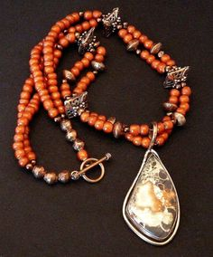 This great Necklace showcases a Peacock Jasper and Copper Pendant by Santa Fe artist David Umpleby. The diamond-shaped Jasper Stone has swirls of coral, cream and chocolate brown, and is encased in a