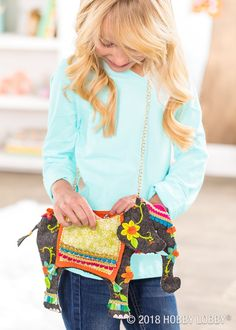 Start with a canvas purse and freestyle embellish with felt trims and embroidery floss!