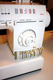 I'm making on of these!!! Pin cushion to wrap around the sewing machine. Genius!.