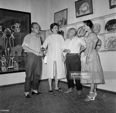 Pablo Picasso talks with friends at the opening of his ceramics exhibition at the Antibes museum, today known as the Picasso Museum, the first museum in the world to be dedicated to the artist on September 7, 1948 in Antibes, France.