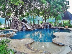 Inground swimming pool with waterfalls and slide and beach access.my dream pool. Living Pool, Outdoor Living, Ideas De Piscina, Platinum Pools, My Pool, Pool With Slide, Pool With Lazy River, Walk In Pool, Backyard Paradise
