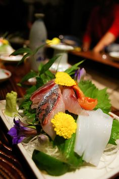 sashimi....a Japanese delicacy consists of very fresh raw meat or fish, sliced into thin pieces
