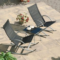 Add a touch of classic comfort to your garden or patio with the 3-piece Black Outdoor Rocking Chair and Table Set. This set is a modern update on a traditional design that you will be sure to enjoy.