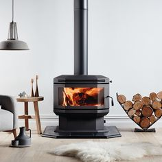 Freestanding combustion fireplace, slate hearth ad and laminate flooring Fancy firewood storage