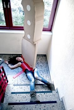 Berlin artists Maria Lujan & Wolfgang Krug are shooting crime scenes with a ridiculously enormous cardboard knife