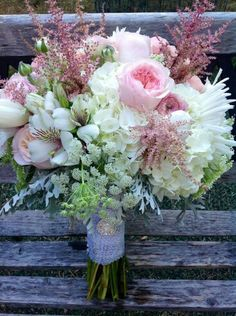 Gorgeous Bouquet With: White Hydrangea, White Peruvian Lilies (Alstroemeria), White Tulips, White Chrysanthemums, Pink English Garden Roses, Pink Astilbe, Pink Ranunculus, Green Queen Anne's Lace, Dusty Miller