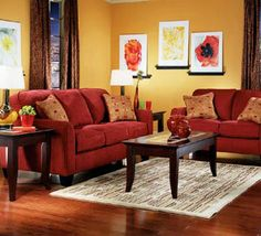 I love these couches. Maybe I would go a little less IThis couch looks similarto one at Rooms To Go, it's a little more red but I like it. I getting bolder in my middle age years!