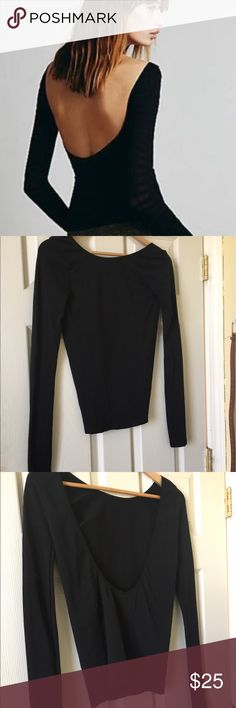 Free People black low back long sleeve top size M Comfy black long sleeve stop by free people with a sexy low back . Worn a few times . Great shape ! Did I mention super comfy 🌼 Free People Tops Tees - Long Sleeve
