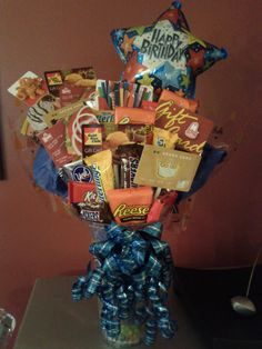 Awesome candy/gift card bouquet my sister and I made for my brothers' birthdays. Turned out amazing.