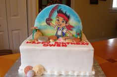 Double sided cake.  One side Minni Mouse and other side Jake from the neverland pirates.  Buttercream cake with fondant design on a cookie.