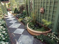 path squares --shady side yard with trellises and fountain