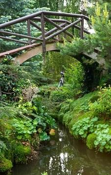 Wooden bridge - Compton Acres, Dorset.  Would love to have a bridge on the property, guess we need a creek first?