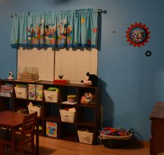 Quintin's finished Mickey Mouse Bedroom!  This is the play area.  Daddy made the vinyl wall gear that is behind the clock on the wall.  :)