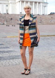 """Salli, 32  """"I bought the self-made dress from a second hand shop. I wonder who has made it and will we ever meet? The vest is second hand, too, the purse by Pieces and the shoes by Bronx."""""""