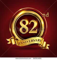 Celebrating 82nd golden anniversary, eighty two years birthday logo celebration with gold ring and golden ribbon.