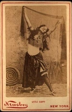 "Famed belly dancer Farida Mazar Spyropoulos, also known as Little Egypt. Farida introduced belly dancing to the United States at the 1893 Chicago World Columbian Exposition.  Her shimmy and shake erotic bellydance was called the ""Hoochie-Koochee.""    Secrets of Charm 