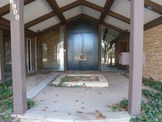 "The generous entry courtyard of this basically abandoned mid-century, Arthur Elrod-style ""Palm Springs"" home in Oklahoma City."