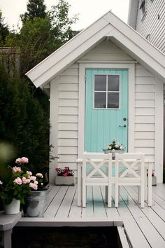 Look at this little shed on the back patio. I love the aqua door, the table and chairs and the tubs of flowers - yes, I love it all! Cubby Houses, Play Houses, Outdoor Spaces, Outdoor Living, Outdoor Decor, Aqua Door, Turquoise Door, Mint Door, The Doors