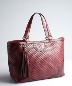 Gucci: burgundy GG embossed leather tooled and pinked tote