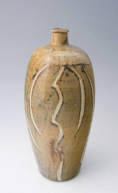Phil Rogers  Tall Bottle, Nuka glaze with Combed decoration 2009