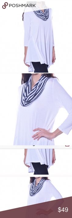 "White and Dark NAVY tunic NWTs various SZs Avail Available in small, Medium and largeMade by Pastels adorable cute pullover 3/4"" sleeves white with navy and white cowl neck. New in package, fabulous style and easy to wear 95% viscose 5% spandex Pastels Clothing Tops Tunics"