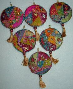 crazy quilt ornaments - great use of all those bits and pieces of silk, trimmings, buttons, etc. that I have oodles of!