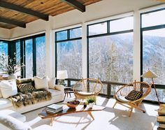 Aerin Lauder's mountain home in Aspen is as magical as winter homes come, with a fluffy white couch topped with a fur throw and glistening walls, it compliments the snowy views