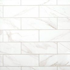Calacatta marble pattern has more warm tones than the Carrera pattern. If we go w a vanity w a white top, the calacatta is an option for shower walls. Prestige Calacatta Polished Ceramic Tile - 6 x 18 - 100507862 Marble Look Tile, Stone Look Tile, Marble Art, Gray Marble, Decorative Tile Backsplash, Kitchen Backsplash, Kitchen Cabinets, Backsplash Ideas, Bathroom Cabinets