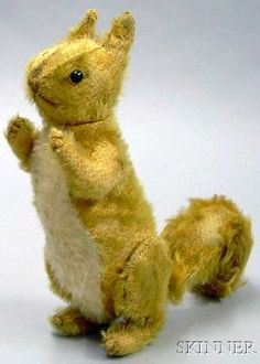 Early Steiff Ginger Mohair Squirrel, c. 1913, with black shoe button eyes, tan embroidered nose, mouth and claws, jointed at head, shoulders and hips.