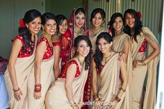 champagne and red bridesmaids sarees
