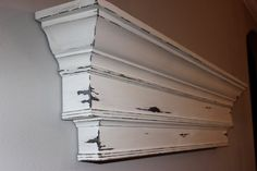 This spectacular triple-tier architectural mantel will add drama and sophistication to any wall or fireplace surround. This custom-designed piece is solidly constructed and finished in a creamy, linen white and carefully distressed in all the right places. I then apply two coats of paste wax to deliver a finish that is smooth to the touch. A special cleat system easily secures the mantel to the wall and all of the necessary mounting hardware is supplied in your package.  This lovely mantel…