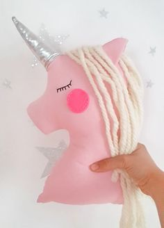 Unicorn pillow nursery decor, pink unicorn with shiny horn, magic plush decor for kids and baby rooms