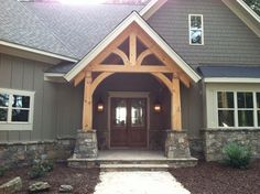 timber accent, ties into stone color, white windows.