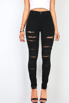 High rise skinny pants with rips and distressing across the front. Pockets on the front and back with a traditional zip fly and button closure. Slight stretch in the material. *Machine Wash Cold Separ
